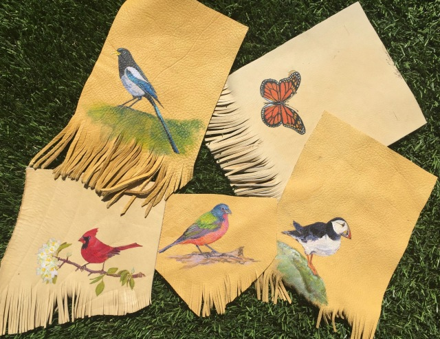 Birds on elk hide